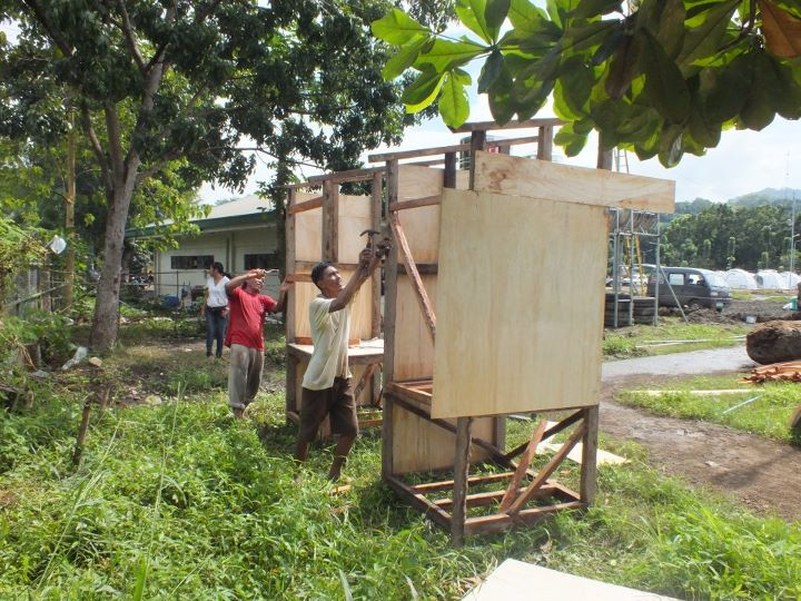 Constructing urine diversion dehydration toilets on the run-down to New Year at Tent City, Iligan, Philippines